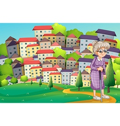 A grandmother with a cane walking at the hilltop vector
