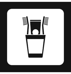 Toothbrush in a cup icon simple style vector image