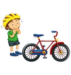 Boy wearing helmet before riding bike vector image