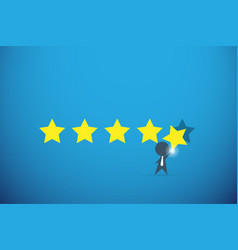 Businessman holding gold star for rating vector