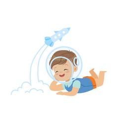 sweet little boy in the astronauts helmet lying on vector image
