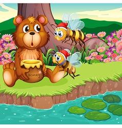 A big bear and bees at the riverbank vector image