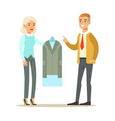 woman employee giving a clean suit jacket to man vector image