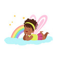 cute little girl with wings lying on her stomach vector image