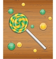 Candy on wooden texture vector image