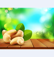 group of cashew nuts lying on a wooden table on vector image