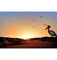 A sunset at the desert with a flock of birds vector image