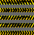 Set of grunge yellow caution tapes vector image