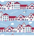 Seamless pattern of white houses and clouds vector image