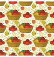 Seamless pattern baskets and tomatoes vector image
