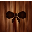 Gift Christmas bow web icon Wooden background vector image
