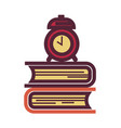 pile of textbooks and old-fashioned mechanic alarm vector image