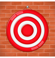 Red target on brick wall vector image