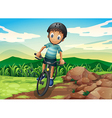 A kid biking at the hilltop vector image