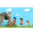 Kids hiking on the waterfall vector image