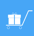 Shopping trolley with gift box vector image