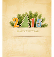 2015 with a Christmas tree on old paper background vector image