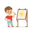 cute little boy painting sun on an easel kids vector image