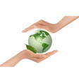 hands holding green globe vector image vector image