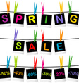Spring sale concept with photo frames hanging on vector image