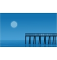 Silhouette of pier on seaside scenery vector image