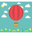 Hot air balloon in the sky and small trees vector image