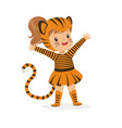 cute happy little girl dressed as a tiger cub vector image