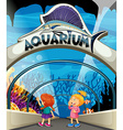 Two girls visiting aquarium vector image