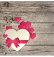 Heart with a bow on a wooden background vector image vector image