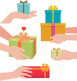 Hand giving a gift box vector image