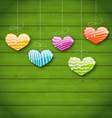 Colorful hearts hanging on green wooden texture vector image vector image