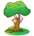 Two girls hiding at the tree vector image