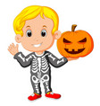 kid with halloween skeleton costume vector image