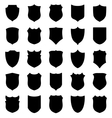 Large set of black shields silhouettes vector image