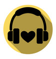 headphones with heart flat black icon vector image