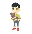 asian happy boy holding a do vector image