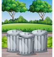 Three trashcans in the park vector image
