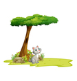 A cat under a tree vector image