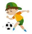 boy kicking soccer ball alone vector image