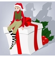 elf sits on the gift vector image