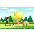 Boy and girl with pets in the park vector image