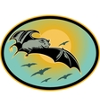 Bat flying with moon in background vector image