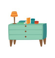 light blue wooden chest of drawers with lamp and vector image