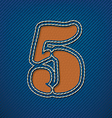 Number 5 made from leather on jeans background vector image