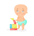 sweet cartoon baby in a diaper playing with toy vector image