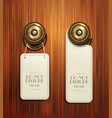 hotel handles with hanging signs on the wooden bac vector image vector image