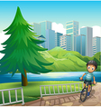 A boy biking across the tall buildings near the vector image