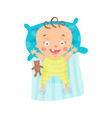 cute cartoon smiling baby lying in his bed vector image