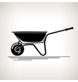 Silhouette a Wheelbarrow on a Light Background vector image