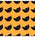 Seamless pattern black cat head vector image